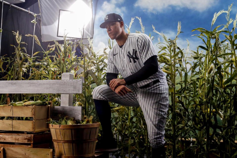 Feb 20, 2020; Tampa, Florida, USA; New York Yankees right fielder Aaron Judge (99) is filmed by Fox for promotion of the Field of Dreams game between the Yankees and the White Sox during media day Mandatory Credit: Butch Dill-USA TODAY Sports
