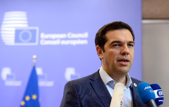 Greek Prime Minister Alexis Tsipras talks to reporters at the end of an Eurozone Summit in Brussels, on July 13, 2015 (AFP Photo/Thierry Charlier)