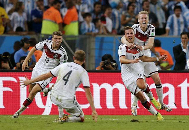 Germany's Mario Goetze, second right, celebrates with teammates after scoring the lone goal during the World Cup final soccer match between Germany and Argentina at the Maracana Stadium in Rio de Janeiro, Brazil, Sunday, July 13, 2014. Germany beat Argentina 1-0 to win its fourth World Cup title. (AP Photo/Frank Augstein)