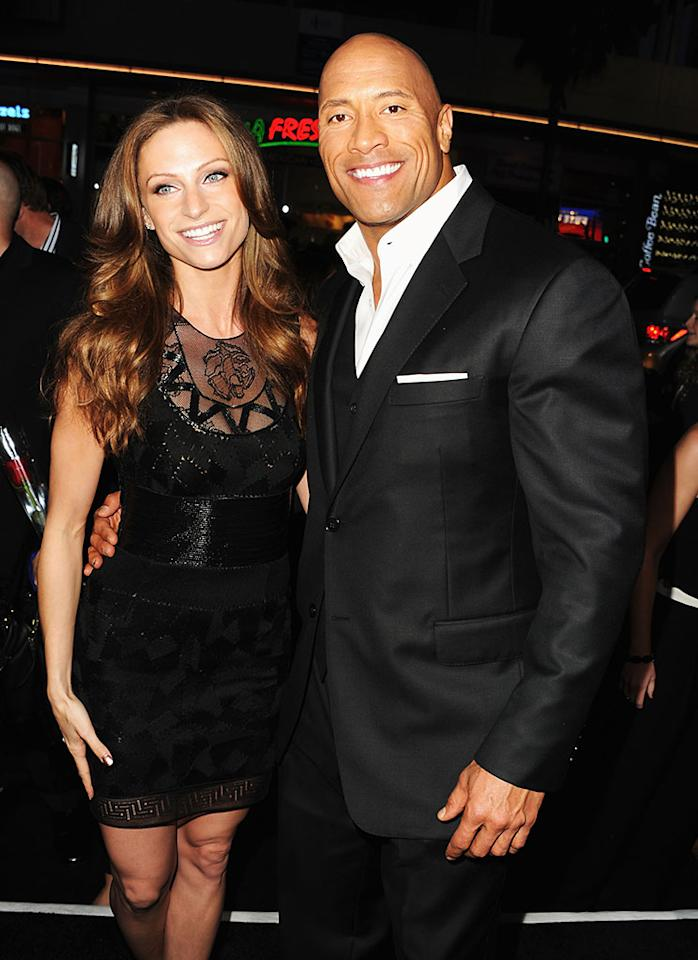 """wayne """"The Rock"""" Johnson (R) and Lauren Hashian attend the premiere of Paramount Pictures' """"G.I. Joe:Retaliation"""" at TCL Chinese Theatre on March 28, 2013 in Hollywood, California.  (Photo by Kevin Winter/Getty Images)"""