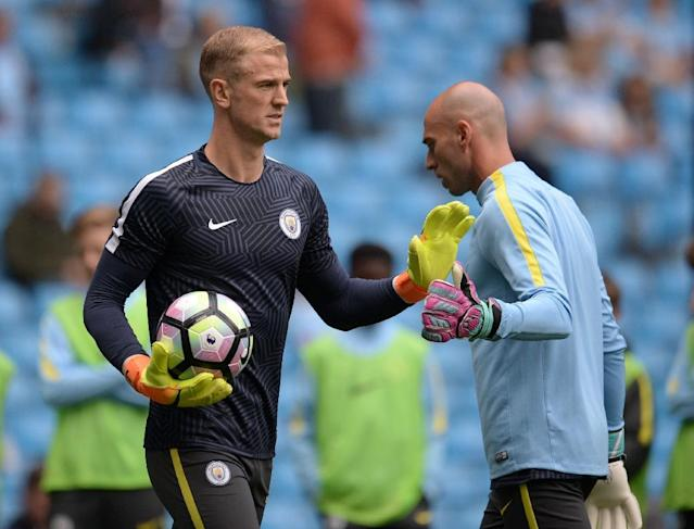 There is likely to be more fustration for Manchester City's unwanted goalkeeper Joe Hart (L) with Willy Caballero (R) taking the starting place against West Ham (AFP Photo/Oli Scarff)
