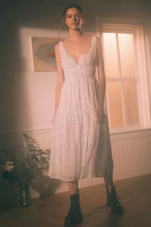 """<h2>Urban Outfitters Anne Smocked Waist Midi Dress</h2><br><strong><em>The TikTok-Approved<br></em></strong><br>Do you know the difference between <a href=""""https://www.refinery29.com/en-us/angelcore-aesthetic-photos"""" rel=""""nofollow noopener"""" target=""""_blank"""" data-ylk=""""slk:angelcore"""" class=""""link rapid-noclick-resp"""">angelcore</a> and <a href=""""https://www.vice.com/en/article/dy8nw7/goblincore-aesthetic-essentials"""" rel=""""nofollow noopener"""" target=""""_blank"""" data-ylk=""""slk:goblincore"""" class=""""link rapid-noclick-resp"""">goblincore</a>? What about dark academia and light academia? If you're curious about the world of <a href=""""https://www.refinery29.com/en-us/2021/03/10353481/core-aesthetic-fashion-trends-tiktok"""" rel=""""nofollow noopener"""" target=""""_blank"""" data-ylk=""""slk:internet """"aesthetics"""" — which are tirelessly catalogued on Tumblr, TikTok"""" class=""""link rapid-noclick-resp"""">internet """"aesthetics"""" — which are tirelessly catalogued on Tumblr, TikTok</a>, and this <a href=""""https://aesthetics.fandom.com/wiki/Aesthetics_Wiki"""" rel=""""nofollow noopener"""" target=""""_blank"""" data-ylk=""""slk:user-generated Wiki"""" class=""""link rapid-noclick-resp"""">user-generated Wiki</a> — we suggest trying this dress on for size. We think it will fall into more than one category. <br><br><strong>The Hype: </strong>4.8 out of 5 stars; 29 reviews on <a href=""""https://www.urbanoutfitters.com/shop/uo-sparklers-chiffon-midi-dress?color=015&type=REGULAR&quantity=1"""" rel=""""nofollow noopener"""" target=""""_blank"""" data-ylk=""""slk:UrbanOutfitters.com"""" class=""""link rapid-noclick-resp"""">UrbanOutfitters.com</a><br><br><strong>What They're Saying: </strong>""""So cottagecore. I feel like a fairy!"""" — Reviewer on UrbanOutfitters.com<br><br><em>Shop <strong><a href=""""https://www.urbanoutfitters.com/"""" rel=""""nofollow noopener"""" target=""""_blank"""" data-ylk=""""slk:Urban Outfitters"""" class=""""link rapid-noclick-resp"""">Urban Outfitters</a></strong></em><br><br><strong>Urban Outfitters</strong> Anne Smocked Waist Midi Dress, $, available at <a href=""""https://go.skimresources"""