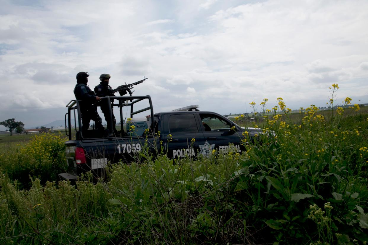 Mexican federal police guard near the Altiplano maximum security prison in Almoloya, west of Mexico City, Sunday, July 12, 2015. (AP Photo/Marco Ugarte)