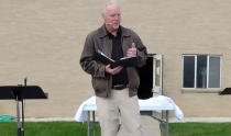 In this Oct. 11, 2020, photo taken from video and provided by Wayne Bakker, former pastor of East Saugatuck Christian Reformed Church, Keith Mannes, leads an outdoor service via Facebook Live in Holland, Mich. Mannes stepped aside from his pastoral role at the church earlier in October 2020 after three decades of ministry, saying he loved his church but felt alienated from the broader institution. (Wayne Bakker via AP)