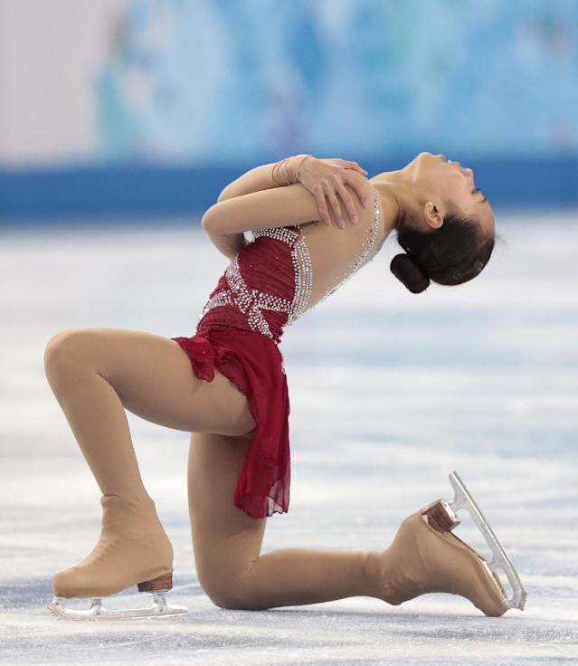 Zhang Kexin of China competes in the women's short program figure skating competition at the Iceberg Skating Palace during the 2014 Winter Olympics, Wednesday, Feb. 19, 2014, in Sochi, Russia. (AP Photo/Ivan Sekretarev)