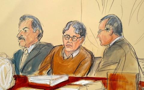 Keith Raniere sits between his attorneys Paul DerOhannesian and Marc Agnifilo in court - Credit: Elizabeth Williams/AP