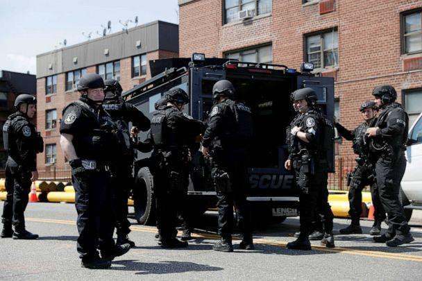 PHOTO: Law enforcement officers stand near the place where the shooter allegedly barricaded himself, after a shooting at a Stop and Shop grocery store, in Hempstead, New York, April 20, 2021. (Shannon Stapleton/Reuters)