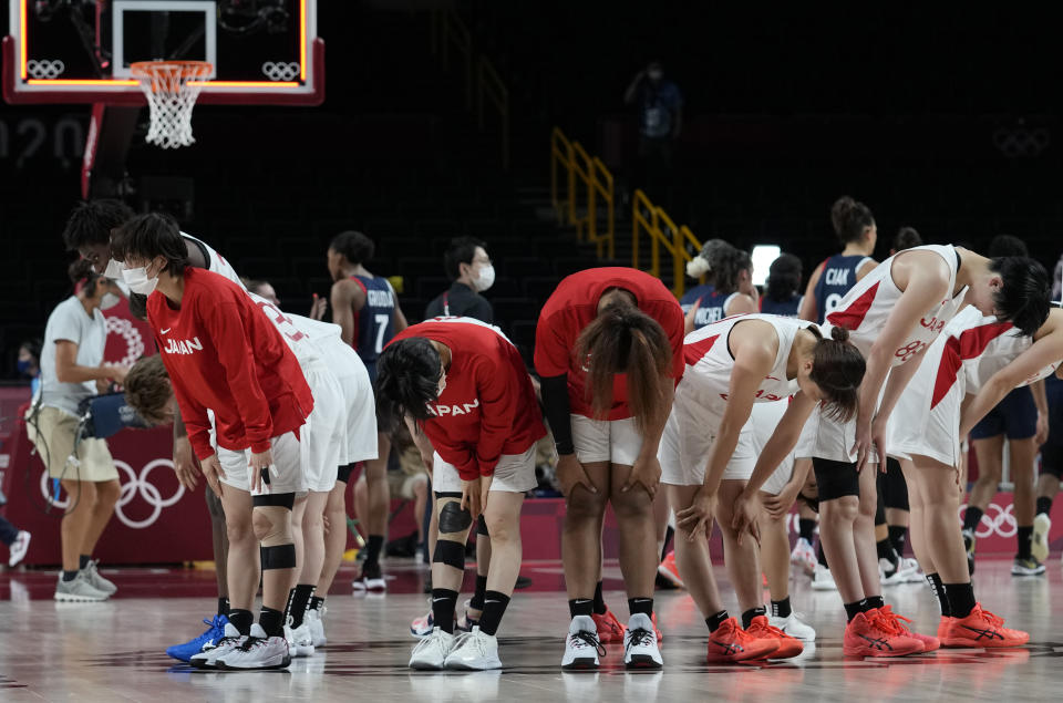 Members of team Japan bow after their win in the women's basketball preliminary round game against France at the 2020 Summer Olympics, Tuesday, July 27, 2021, in Saitama, Japan. (AP Photo/Eric Gay)