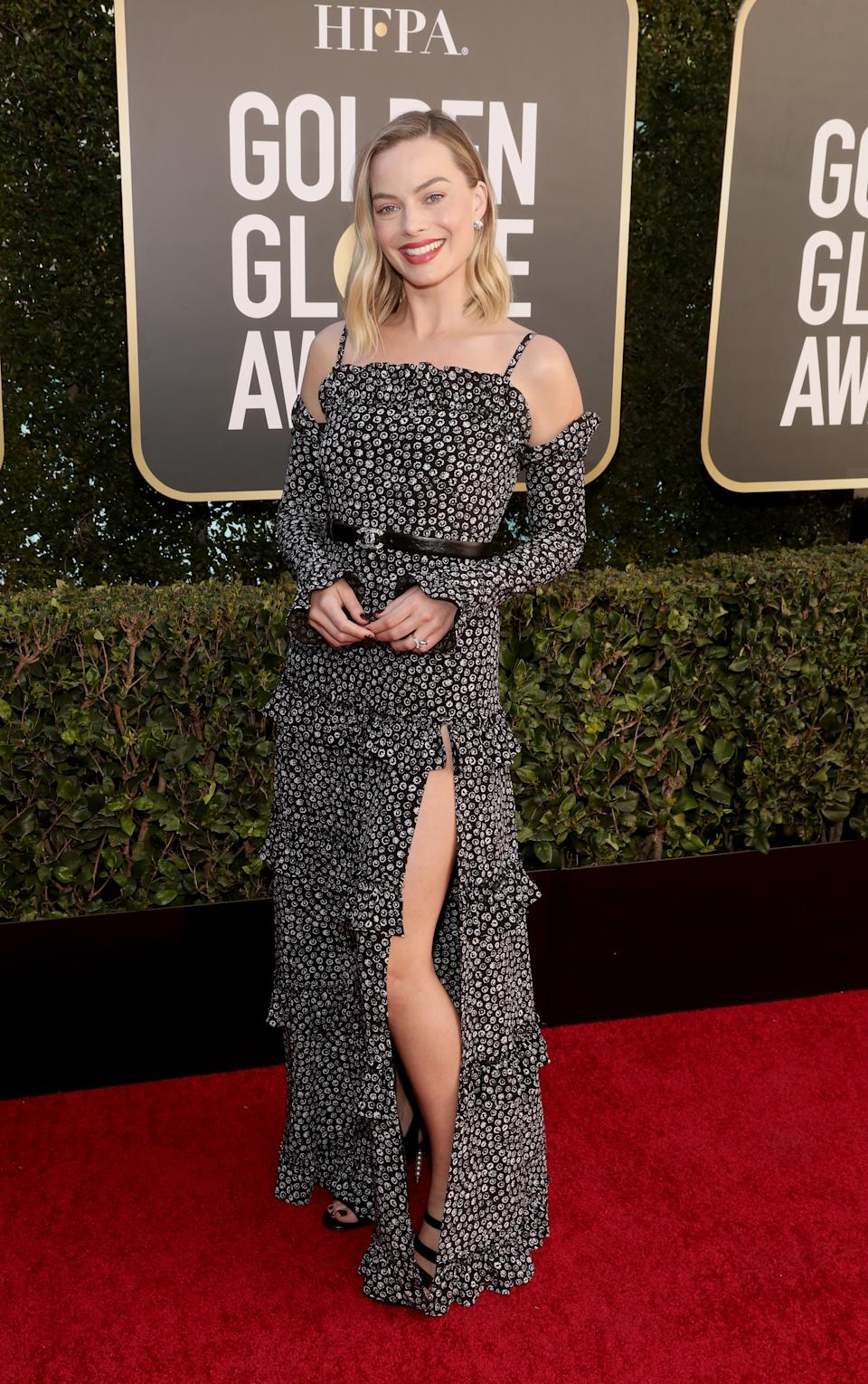 Margot Robbie wears a black and white Chanel dress at the 78th Annual Golden Globe Awards held at The Beverly Hilton and broadcast on February 28, 2021 in Beverly Hills, California.