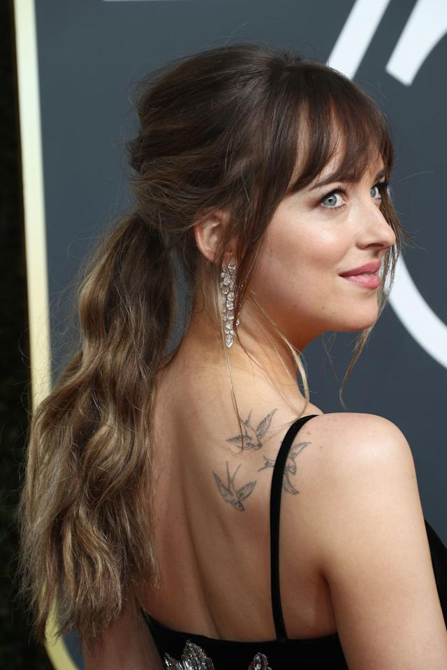 <p>Dakota Johnson's ponytail has anything you could ever need: the length, the waves, the wisps perfectly framing her face. Opting for a wavy ponytail instead of a straight one will make your hair seem thicker and longer, which is like, always the goal. </p>