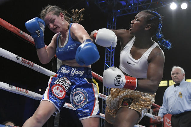 Claressa Shields (R), shown in a Dec. 8 victory over Femke Hermans, will meet Christina Hammer in a bout for the undisputed middleweight championship on April 13 in Atlantic City.