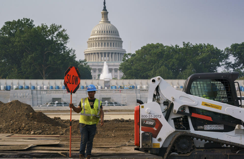 Workers repair a park near the Capitol in Washington, Wednesday, July 21, 2021, as senators struggle to reach a compromise over how to pay for nearly $1 trillion in public works spending, a key part of President Joe Biden's agenda. (AP Photo/J. Scott Applewhite)