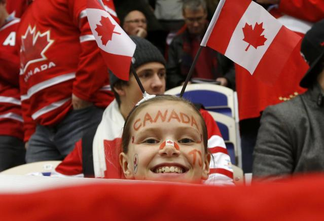 A Canadian fan watches during play between Canada and the Czech Republic during the first period of their IIHF World Junior Championship ice hockey game in Malmo, Sweden, December 28, 2013. REUTERS/Alexander Demianchuk (SWEDEN - Tags: SPORT ICE HOCKEY)