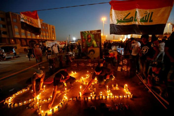Iraqis march in Najaf on the anniversary of the anti-government protests