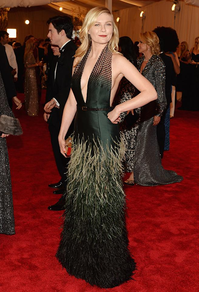 We love everything about Kirsten Dunst's sophisticated Louis Vuitton gown. From its more acidic green tones to the regal emerald body, the playful textures topped off with a super-casual blowout of her blond locks.