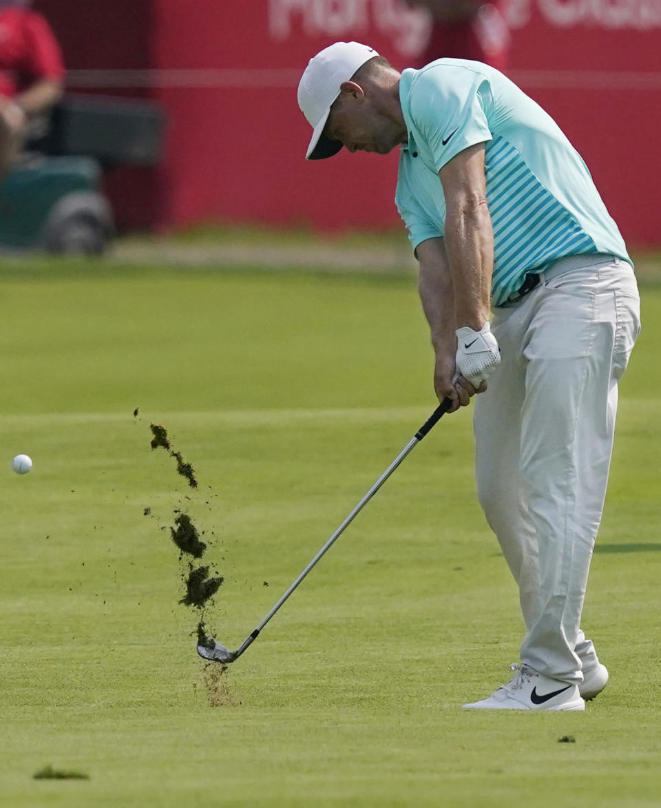 Alex Noren of Sweden his his approach shot onto the 18th green during the final round of the Rocket Mortgage Classic golf tournament, Sunday, July 4, 2021, at the Detroit Golf Club in Detroit. (AP Photo/Carlos Osorio)