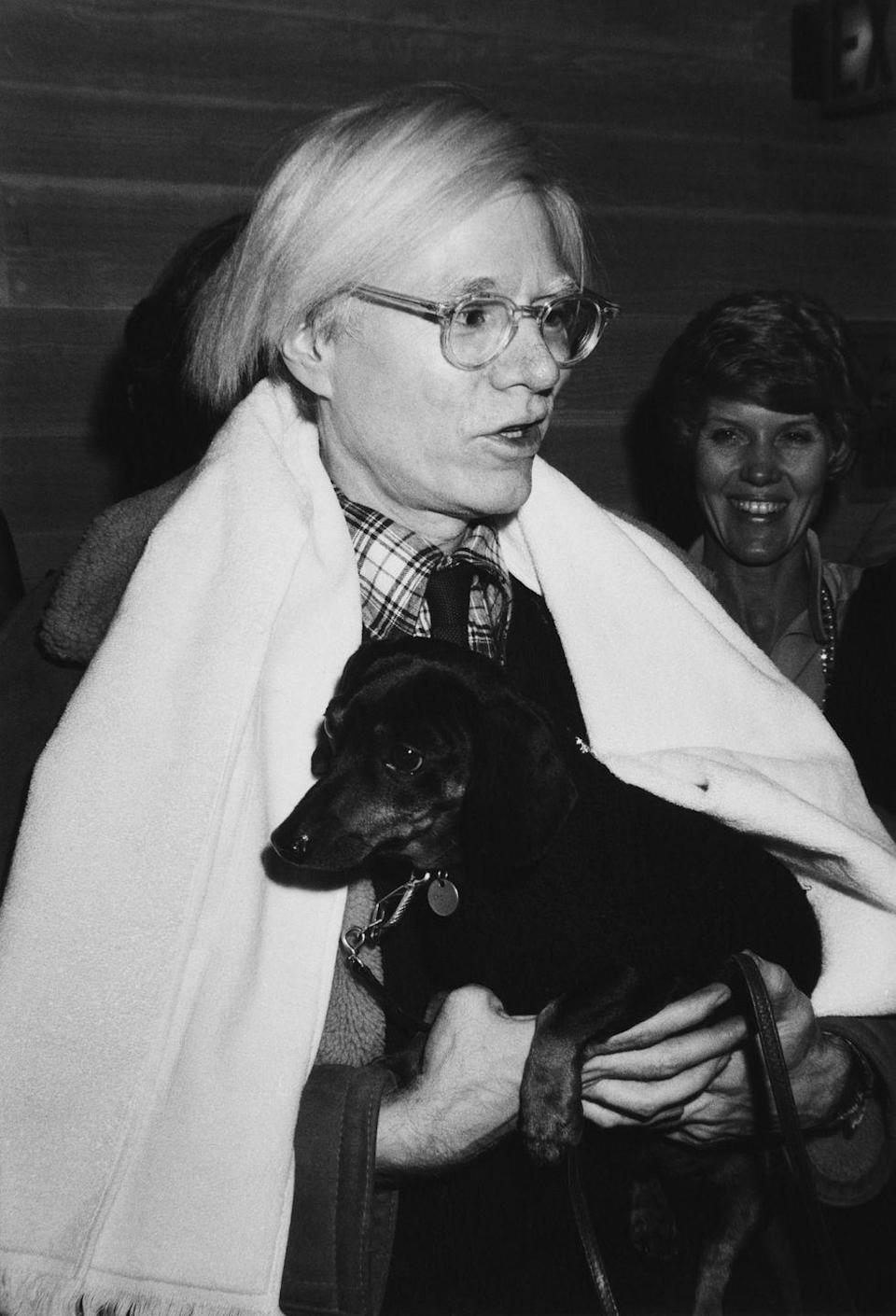 <p>Even New York City's social elite ate at McDonald's back in the day! Here, Andy Warhol attends a black tie dinner hosted at a McDonald's on Fifth Avenue in aid of the Muscular Dystrophy Association. His plus one? His beloved dachshund, Archie.</p>