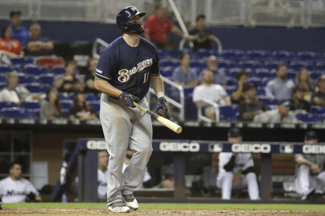 Milwaukee Brewers' Mike Moustakas (11) watches after hitting a two run home run during the ninth inning of a baseball game against the Miami Marlins, Wednesday, Sept. 11, 2019, in Miami. The Brewers won 7-5. (AP Photo/Lynne Sladky)