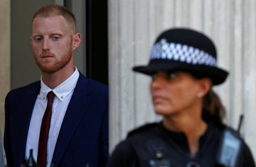 England cricketer Ben Stokes (L) leaves Bristol Crown Court on August 6