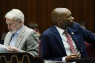 House Minority Leader Reginald Bolding, D-Laveen, right, pauses on the Arizona House floor along with Rep. Randall Friese, D- Tucson, left, during a vote on part of the Arizona budget, SB1828 on taxation, at the Arizona Capitol Thursday, June 24, 2021, in Phoenix. (AP Photo/Ross D. Franklin)