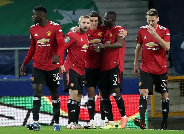 Edinson Cavani (centre) scored with two minutes remaining and Anthony Martial added second in injury time as United beat Everton