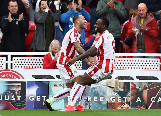 Jese and Saido Berahino celebrate after Stoke took the lead against Arsenal