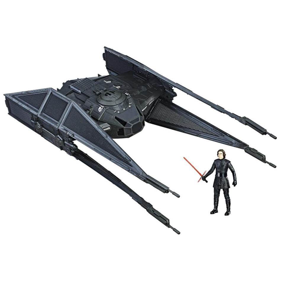 """<p>""""Track down Resistance pilots with Kylo dangerously fast TIE Silencer! Like his father Han Solo, Kylo Ren navigates the <em>Star Wars</em> galaxy with precision and ease, but he uses his high-speed vehicle to fight for the Dark Side… The movie-accurate design of this 3.75-inch scale vehicle even features a pop-out torpedo launcher! The vehicle and figure are Force Link-enabled; watch the lights illuminate in the rear of the vehicle as well as phrases and sounds activated by the wearable technology."""" $49.99 (Photo: Hasbro) </p>"""