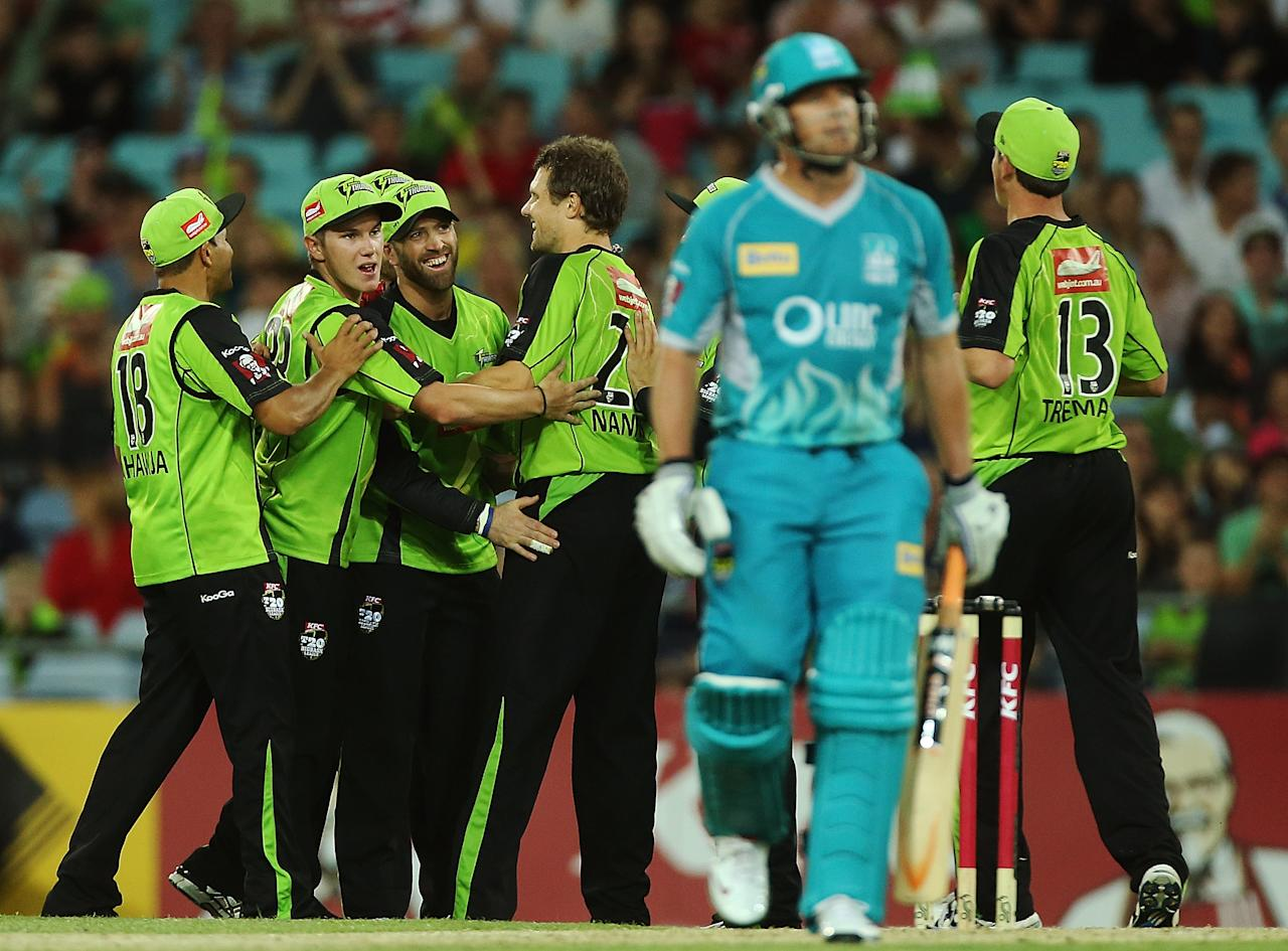 SYDNEY, AUSTRALIA - DECEMBER 28:  Matt Prior of the Thunder celebrates with teammates after taking a catch to dismiss James Hopes of the Heat during the Big Bash League match between the Sydney Thunder and the Brisbane Heat at ANZ Stadium on December 28, 2012 in Sydney, Australia.  (Photo by Mark Metcalfe/Getty Images)