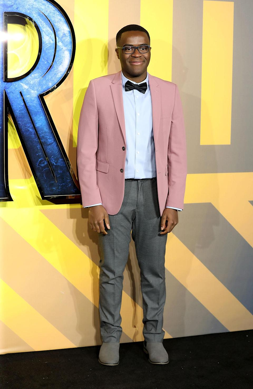 <p>The former 'Great British Bake Off' contestent wore a pink dinner jacket with a bow tie for the premiere. <em>[Photo: Getty] </em> </p>