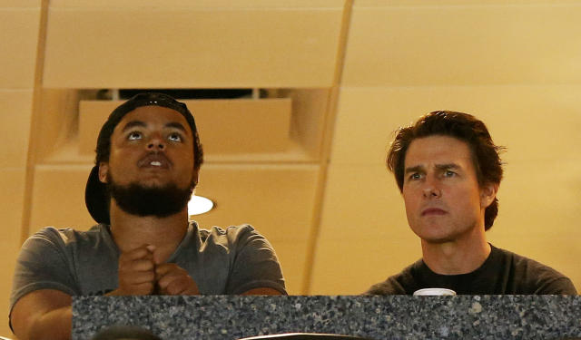 TAMPA, FL - APRIL 05: Actor Tom Cruise (R) and his son Connor Cruise watch the Maryland Terrapins play against the Connecticut Huskies during the NCAA Women's Final Four Semifinal at Amalie Arena on April 5, 2015 in Tampa, Florida. (Photo by Mike Carlson/Getty Images)