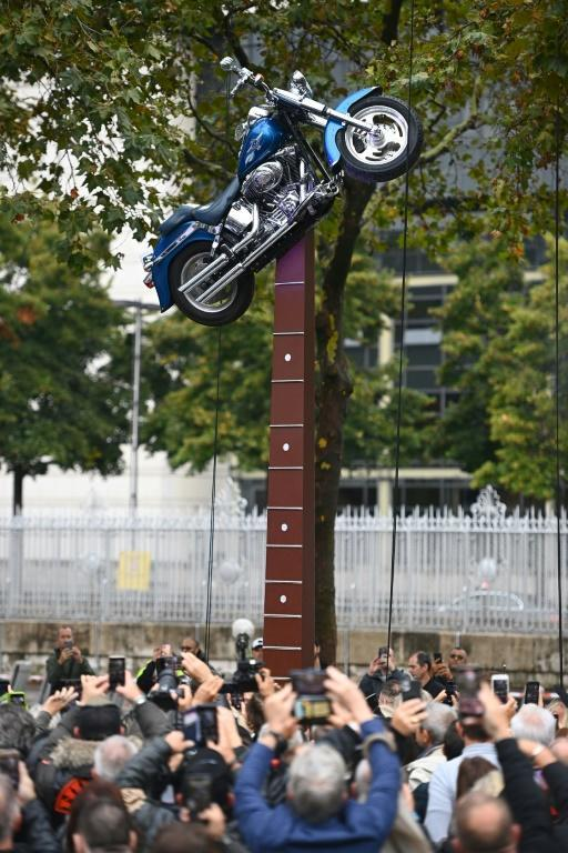 The new statue features Hallyday's beloved Harley Davidson perched on the end of a guitar (AFP/Christophe ARCHAMBAULT)