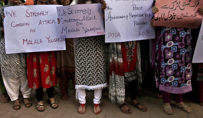 "Pakistani women, hold banners during a protest condemning the attack on schoolgirl Malala Yousufzai, in Islamabad, Pakistan, Wednesday, Oct. 10, 2012. Pakistani doctors successfully removed a bullet Wednesday from the neck of a 14-year-old girl who was shot by the Taliban for speaking out in support of education for women, a government minister said. Banner top right reads, "" The Taliban is afraid of an unarmed girl.""(AP Photo/Muhammed Muheisen)"