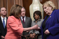 House Speaker Nancy Pelosi of Calif., second from left, gives a pen to Rep. Zoe Lofgren, D-Calif., right, after she signed the resolution to transmit the two articles of impeachment against President Donald Trump to the Senate for trial on Capitol Hill in Washington, Wednesday, Jan. 15, 2020. The two articles of impeachment against Trump are for abuse of power and obstruction of Congress. Other looking on are, from left, House Intelligence Committee Chairman Adam Schiff, D-Calif., House Ways and Means Committee Chairman Rep. Richard Neal, D-Mass., and House Financial Services Committee Chairwoman Maxine Waters, D-California. (AP Photo/Susan Walsh)