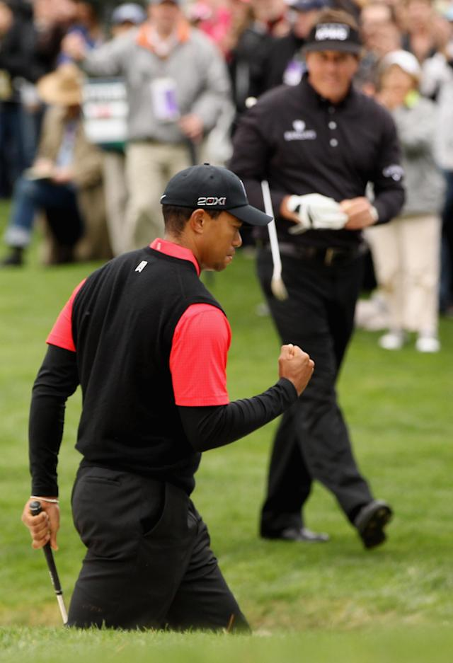PEBBLE BEACH, CA - FEBRUARY 12: Tiger Woods celebrates chipping in for birdie from a greenside bunker on the 12th hole during the final round of the AT&T Pebble Beach National Pro-Am at Pebble Beach Golf Links on February 12, 2012 in Pebble Beach, California. (Photo by Ezra Shaw/Getty Images)