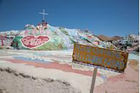 "<p>This<a href=""https://salvationmountain.us/"" rel=""nofollow noopener"" target=""_blank"" data-ylk=""slk:brightly painted mountain in Niland, California"" class=""link rapid-noclick-resp""> brightly painted mountain in Niland, California</a>, was designed by Leonard Knight as a tribute to God, with the big message ""God Is Love"" at the center. The mountain stands 50 feet tall and 150 feet across and is made of clay and painted with biblical messages.</p>"