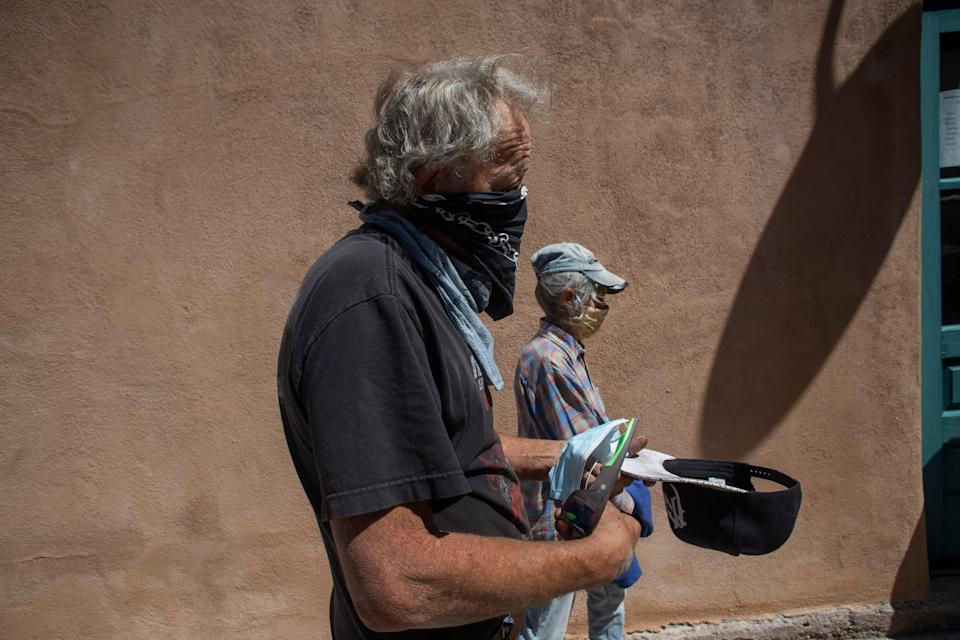 Timothy Dusharm waits in line to enter the Hillsboro Community Center in New Mexico where he received a COVID-19 vaccination.
