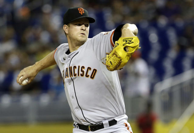 San Francisco Giants' Matt Cain pitches against the Miami Marlins in the first inning of a baseball game, Saturday, Aug. 17, 2013, in Miami. (AP Photo/Alan Diaz)