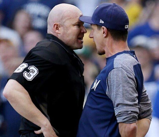 Manager Craig Counsell goes 'head-to-head' with umpire Mike Estabrook over missed calls and ejections in Brewers loss. (Getty Images)