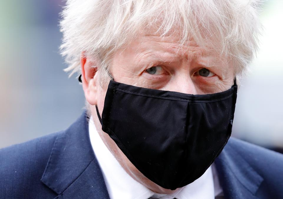 LONDON, UNITED KINGDOM - NOVEMBER 11: (EMBARGOED FOR PUBLICATION IN UK NEWSPAPERS UNTIL 24 HOURS AFTER CREATE DATE AND TIME) Prime Minister Boris Johnson (seen wearing a face mask) attends a service to mark the centenary of the burial of the Unknown Warrior at Westminster Abbey on November 11, 2020 in London, England. The service is to commemorate the funeral of an unknown British serviceman, the Unknown Warrior, whose body was brought from Northern France and buried at the west end of the nave in Westminster Abbey on 11th November 1920 to represent all those who lost their lives in the First World War but whose place of death was not known, or whose bodies remained unidentified. (Photo by Max Mumby/Indigo/Getty Images/Pool)