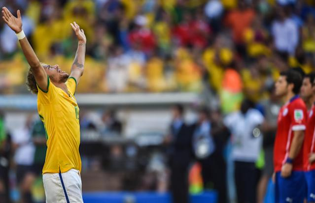 Brazil's forward Neymar celebrates after scoring during the penalty shoot out after extra-time in the Round of 16 football match between Brazil and Chile at the Mineirao Stadium in Belo Horizonte during the 2014 FIFA World Cup on June 28, 2014 (AFP Photo/Gustavo Andrade )