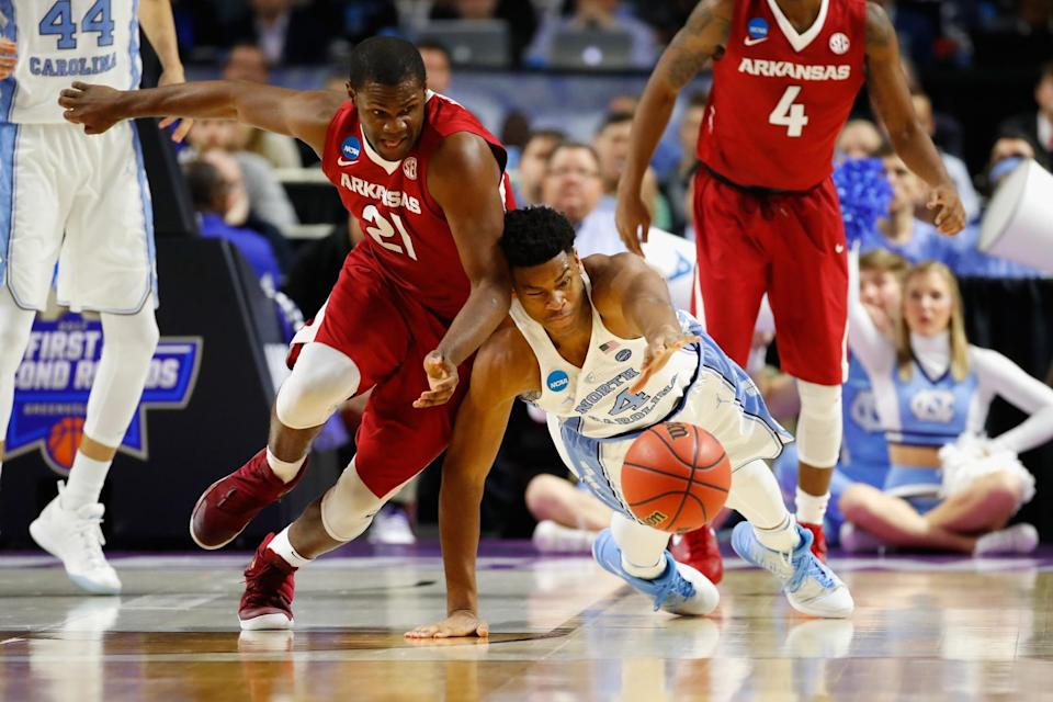 <p>Manuale Watkins #21 of the Arkansas Razorbacks battles for a loose ball with Isaiah Hicks #4 of the North Carolina Tar Heels in the second half during the second round of the 2017 NCAA Men's Basketball Tournament at Bon Secours Wellness Arena on March 19, 2017 in Greenville, South Carolina. (Photo by Gregory Shamus/Getty Images) </p>