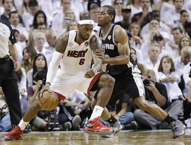 San Antonio Spurs' Kawhi Leonard (2) defends against Miami Heat's LeBron James (6) during the first half in Game 7 of the NBA basketball championships, Thursday, June 20, 2013, in Miami. (AP Photo/Lynne Sladky)