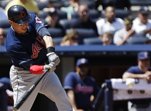 Cleveland Indians' Asdrubal Cabrera htis an RBI single during the fifth inning of a baseball game against the New York Yankees Wednesday, June 27, 2012, in New York. (AP Photo/Frank Franklin II)