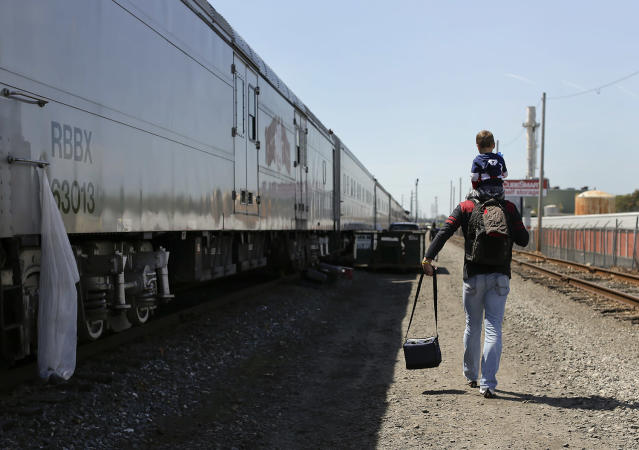 """<p>Ringling Bros. boss clown Sandor Eke carries his 2-year-old son, Michael, on his shoulders as he walks to the bus that will take them to the arena for a show, Thursday, May 4, 2017, in Providence, R.I. Someday, he plans to teach his son juggling and other circus skills, but Eke knows he may never join the circus. Eke's wife, a former circus aerialist, has already established their new home in Las Vegas. When the circus closes, Eke hopes to get a job as a """"flair"""" bartender there, doing tricks like juggling bottles, but he wonders how life will change. """"My normal life is this. My normal life is going on the train, going every week to a different city. It's crazy how much I love circus,"""" Eke says. (Photo: Julie Jacobson/AP) </p>"""