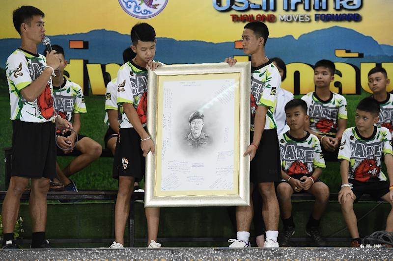 The boys paid tribute to Saman Kunan, a former Thai Navy SEAL who died during the rescue operation (AFP Photo/LILLIAN SUWANRUMPHA                 )