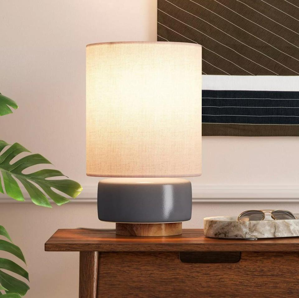 <p>The ceramic and wood materials of this <span>Project 62 Ceramic Table Lamp With Wood Base</span> ($40) pay subtle homage to the great outdoors. Translation? It's the perfect light fixture for fall.</p>