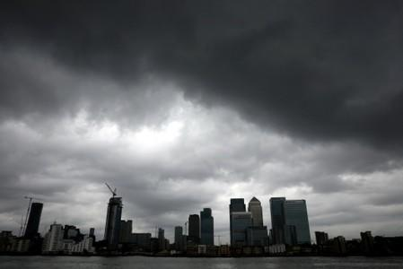 Rain clouds pass over the Canary Wharf financial district in London