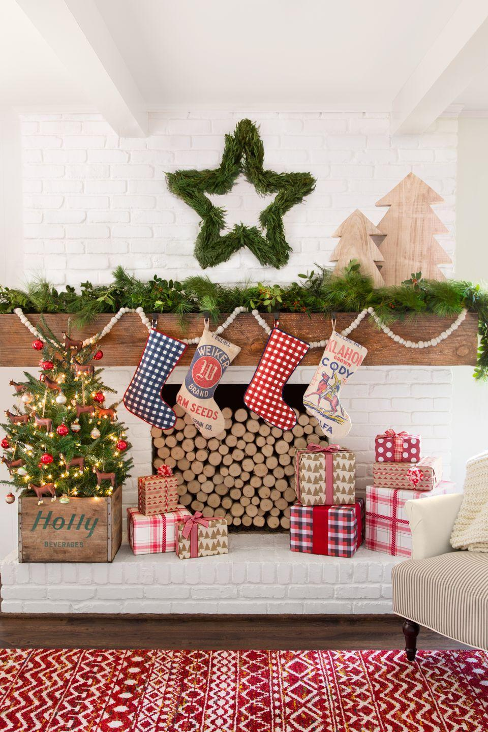"""<p>A wreath in the shape of a star, bright and cheery presents, and country-style stockings create the perfect Christmas scene.</p><p><strong><a class=""""link rapid-noclick-resp"""" href=""""https://go.redirectingat.com?id=74968X1596630&url=https%3A%2F%2Fwww.etsy.com%2Flisting%2F492911699%2Fchristmas-stocking-stocking-cowboy&sref=https%3A%2F%2Fwww.countryliving.com%2Fhome-design%2Fdecorating-ideas%2Fadvice%2Fg1247%2Fholiday-decorating-1208%2F"""" rel=""""nofollow noopener"""" target=""""_blank"""" data-ylk=""""slk:SHOP STOCKINGS"""">SHOP STOCKINGS</a></strong></p>"""