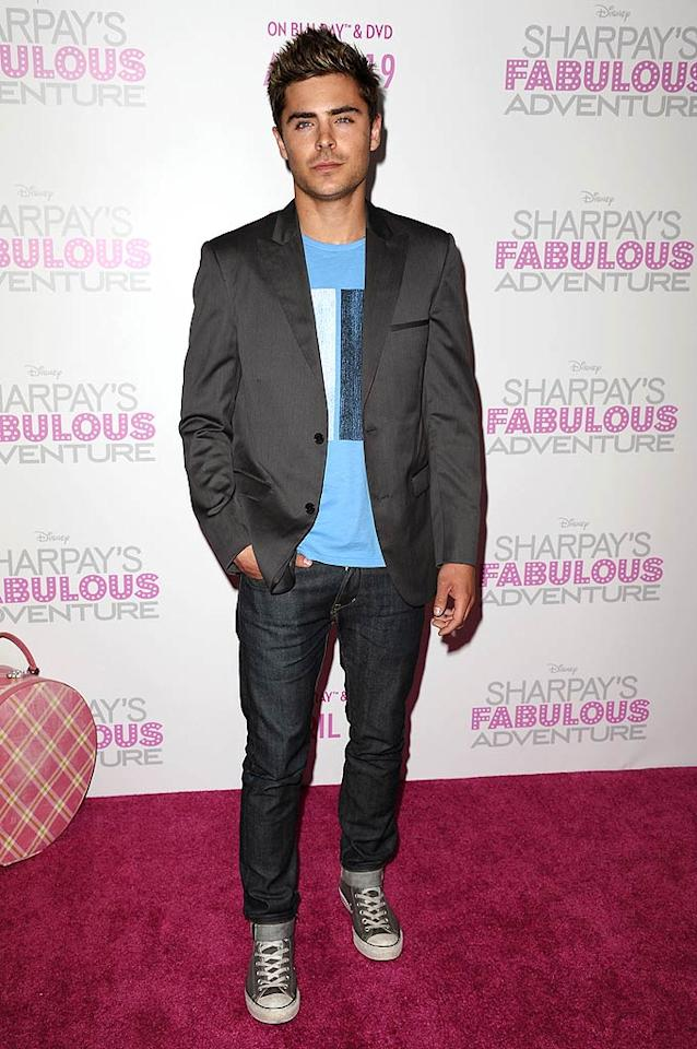 "The now hunky Zac Efron, 23, with his Hollywood hair, light scruff, and dark duds, was there to support his friend on her big night. Jason LaVeris/<a href=""http://www.filmmagic.com/"" target=""new"">FilmMagic.com</a> - April 6, 2011"