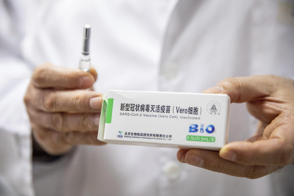 Csaba Lengyel, President of the University of Szeged's Szent-Gyorgyi Albert Clinic Center shows a pack of the vaccine against COVID-19 produced by Chinese Sinopharm at the university in Szeged, Hungary, Wednesday, February 24, 2021. (Tibor Rosta/MTI via AP)